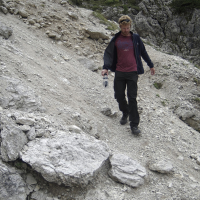 Al walking along a scree slope
