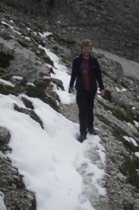 Al Walking along the snowy scree slope