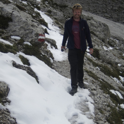 Al Walking along the snowy scree slope