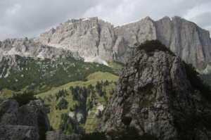 Blue Sky, summit of Sas Ciampiac and rlolling green hills below