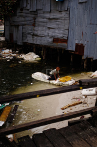 Boy on the rubbish Raft