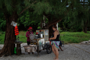Gemma buying palm sugar at Koh tuic
