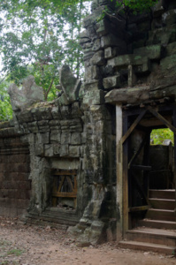 The outer wall of the Baphoun, with a supported doorway