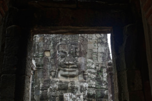Another Lokesvara seen through a doorway on the upper level of the Bayon Temple